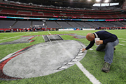 Ed Mangan of Atlanta, Ga. puts the finishing touch on the field for the start of the Super Bowl on Sunday, February 5, 2017 at NRG Stadium in Houston, TX, USA. Photo by Curtis Compton/Atlanta Journal-Constitution/TNS/ABACAPRESS.COM