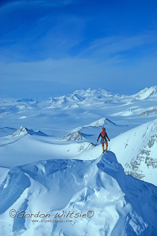 ANTARCTICA, Queen Maud Mountains. Vern Tejas (MR) surveys route on 10,302-foot Mount Vaughan, near the South Pole, up which he is guiding Norman Vaughan, 88, after whom the peak was named in 1929 by Richard Byrd in honor of Vaughan's participation in Byrd's 1929 expedition to fly over the Pole. Trans-Antarctic Mountains.