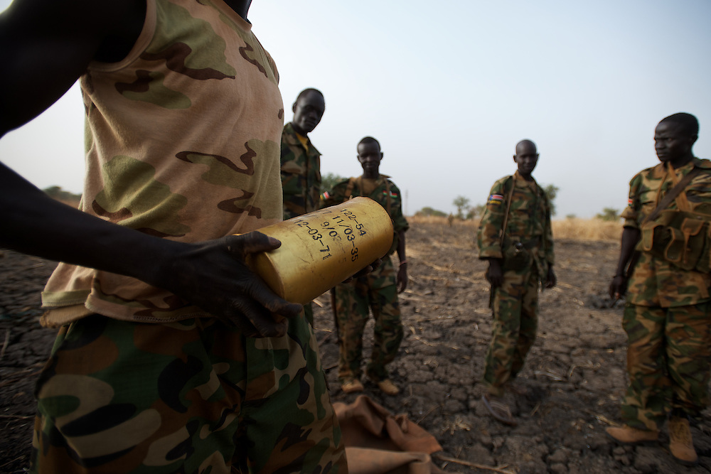 April 24, 2012 - Panakuach, South Sudan: A group of SPLA soldiers prepares missiles at the last defensive line outside the village of Panakuach, 70 kilometers north of Bentiu...South Sudan and their northern neighbors, Sudan, have in the past two weeks been involved in heavily clashes over border disputes. Bentiu and neighboring villages have been under constant bombardment by the troops os Karthoum , who established their positions around 10 kilometers into South Sudan's territory. The international community is concerned about the possibility of a full on war between the two countries. (Paulo Nunes dos Santos/Polaris)