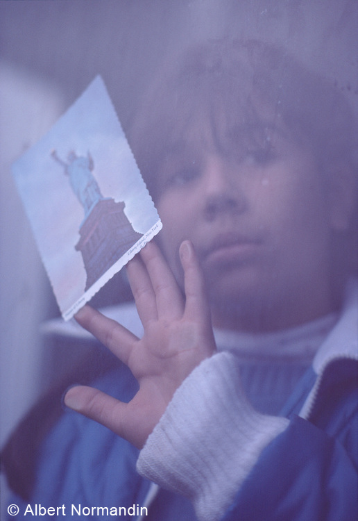 Young Girl in Empire State Building Window, New York City, New York, USA, November 1982