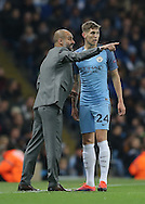 Josep Guardiola manager of Manchester City directs John Stones of Manchester City during the Champions League Group C match at the Etihad Stadium, Manchester. Picture date: November 1st, 2016. Pic Simon Bellis/Sportimage