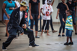 Joachim Samuel Vaughn (right) gets moves from Invincible dancer Lavon Patterson.  Dancers from Invicible, a Michael Jackson tribute, will perform at Reichhold Center for the Arts Saturday at 7pm.  Tutu Park Mall.  1 November 2013.  © Aisha-Zakiya Boyd