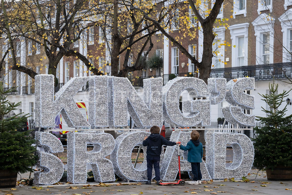 During the second Coronavirus lockdown when most non-essential retailers and small businesses remain closed by order of the government, Christmas themed lettering is on the King's Road in Chelsea, on 13th November 2020, in London, England.