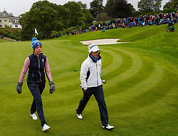 Auchterarder, Scotland, UK. 14 September 2019. Saturday afternoon Fourballs matches  at 2019 Solheim Cup on Centenary Course at Gleneagles. Pictured; Georgia Hall and Celine Boutier of team Europe walk off the 11th green after halving hole, Iain Masterton/Alamy Live News