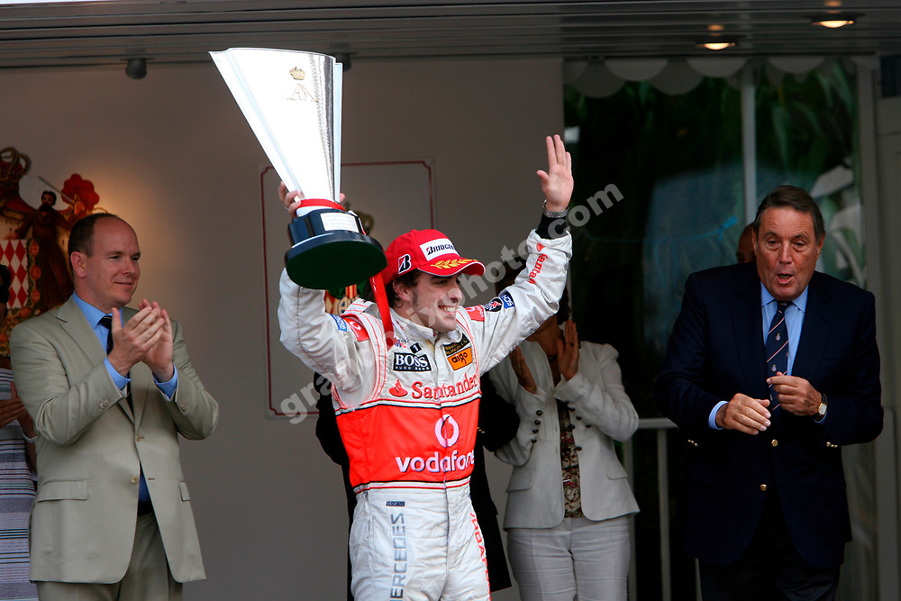 Fernando Alonso (McLaren-Mercedes) with the trophy after the 2007 Monaco Grand Prix.  Also on the podium: Prince Albert and Michel Boeri. Photo: Grand Prix Photo