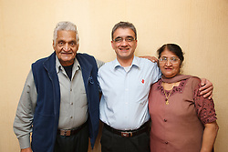 Son with elderly south Asian parents.