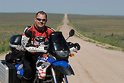 James Pratt on BMW F650GS Dakar on lonely dirt road in Oklahoma panhandle