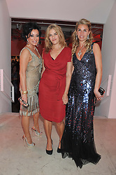 Left to right, NANCY DELL'OLIO, TRACEY EMIN and ASSIA WEBSTER at a dinner in aid The Journalism Foundation held at Philips De Pury & Company, Howick Place, London, SW1 on 22nd May 2012.