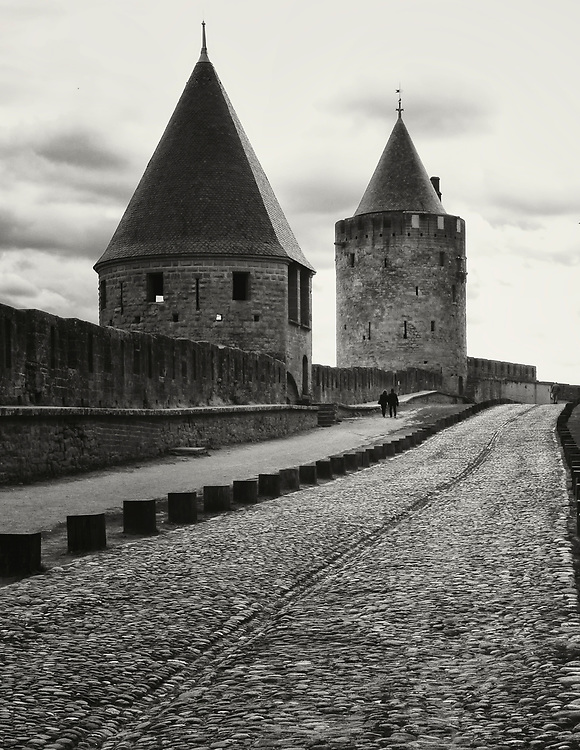 While touring southern France we took a break from discovering new roads and made a stop at the medieval walled city of Carcassonne.  The massive stone walls of the city stretch nearly two miles and are topped with fifty-two towers.