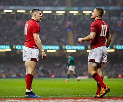 Josh Adams of Wales with team-mate Gareth Anscombe<br /> <br /> Photographer Simon King/Replay Images<br /> <br /> Six Nations Round 5 - Wales v Ireland - Saturday 16th March 2019 - Principality Stadium - Cardiff<br /> <br /> World Copyright © Replay Images . All rights reserved. info@replayimages.co.uk - http://replayimages.co.uk