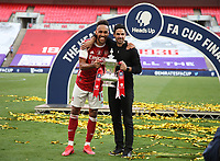 Football - 2020 Emirates 'Heads Up' FA Cup Final - Arsenal vs. Chelsea <br /> <br /> Arsenal captain Pierre-Emerick Aubameyang and head coach Mikel Arteta celebrate victory with the trophy, at Wembley Stadium.<br /> <br /> The match is being played behind closed doors because of the current COVID-19 Coronavirus pandemic, and government social distancing/lockdown restrictions.
