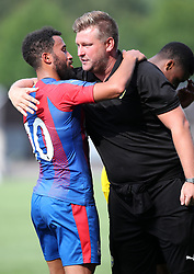 Crystal Palace's Andros Townshend embraces Oxford United manager Karl Robinson after the final whistle during a pre season friendly match at The Kassam Stadium, Oxford.
