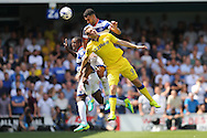 Steven Caulker of QPR (top) and Nedum Onuoha of QPR (l)  head the ball over Chris Wood of Leeds United. Skybet EFL championship match, Queens Park Rangers v Leeds United at Loftus Road Stadium in London on Sunday 7th August 2016.<br /> pic by John Patrick Fletcher, Andrew Orchard sports photography.