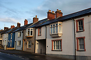 Residential homes in Cardigan, Pembrokeshire, Wales, United Kingdom. Cardigan is a town and community in the county of Ceredigion in Wales. The town lies on a tidal reach of the River Teifi at the point where Ceredigion, formerly Cardiganshire, meets Pembrokeshire. Cardigan was the county town of the historic county and is the second-largest town in Ceredigion.
