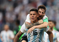SAINT PETERSBURG, June 26, 2018  Argentina's Marcos Rojo (bottom) celebrates scoring with Lionel Messi during the 2018 FIFA World Cup Group D match between Nigeria and Argentina in Saint Petersburg, Russia, June 26, 2018. Argentina won 2-1 and advanced to the round of 16. (Credit Image: © Yang Lei/Xinhua via ZUMA Wire)