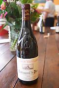 bottle with moulded relief on the neck domaine du vieux lazaret chateauneuf du pape rhone france