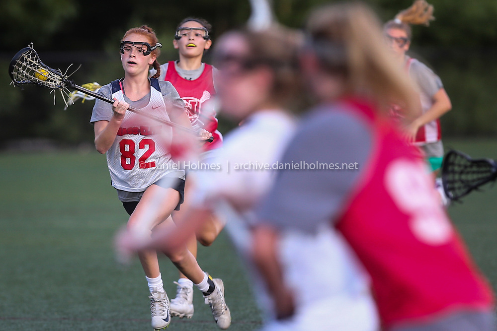 Franklin's Erin Walsh takes the ball up field during the Gold Star Lacrosse league game against Natick at Medway High School, on Jul. 20, 2020. [Daily News and Wicked Local Photo/Dan Holmes]