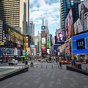 Times Square streets remain sparse to both visitors and traffic during the Coronavirus (Covid-19) pandemic on Tuesday, January 19, 2021 in Manhattan, New York. (Alex Menendez via AP)
