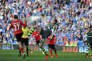 Stoke city's Peter Crouch challenges Cardiff's Juan Cala . Barclays Premier league match, Cardiff city  v Stoke city at the Cardiff city stadium in Cardiff, South Wales on Saturday 19th April 2014. pic by Andrew Orchard, Andrew Orchard sports photography,