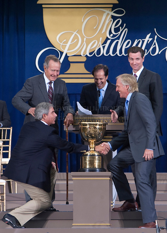 US team captain Fred Couples (L) shakes hands with International team captain Greg Norman as Former President George H.W. Bush, NBC anchor Dan Hicks and San Francisco Mayor Gavin Newsom look on during opening ceremonies of the 2009 Presidents Cup at Harding Park Golf Course October 7, 2009 in San Francisco, California.  Photograph by David Paul Morris