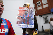 'Kayla' the Eagle holding up a CPFC Membership 2016/17 ticket flyer outside Selhurst Park before k/o. Barclays Premier League match, Crystal Palace v Stoke City at Selhurst Park in London on Saturday 7th May 2016. pic by John Patrick Fletcher, Andrew Orchard sports photography.