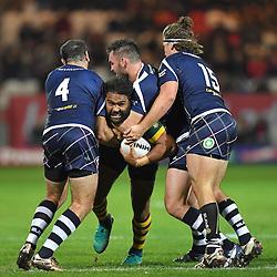 Australia's Sam Thaiday is tackled by Scotland's Luke Douglas, Kane Linnett and Sheldon Powe Hobbs during the Ladbrokes Four Nations match at the KC Lightstream Stadium, Hull.