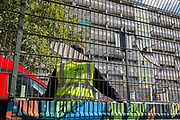 Emergency Services vehicles are parked by a basketball court in the aftermath of a flat fire in one of the two Wendover blocks in Alsace Road on the Aylesbury Estate, Southwark SE17, on 24th September 2018, in London, England. Part of a split level flat on the fourth and fifth floor of the 15-storey block was damaged. One woman and two children left the property before the Brigade arrived. They were treated at the scene for smoke inhalation by London Ambulance Service crews and taken too hospital. Another man was also treated at the scene for smoke inhalation.