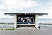 The commissioned portraits by the photographer Niall McDiarmid are displayed on a seafront promenade shelter at Llandudno, on 4th October 2021, in Llandudno, Gwynedd, Wales.
