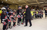 "Merrill Fay is welcomed onto the ice by a large crowd of ""lakers"" gathered for the celebration in his honor naming the Laconia Ice Arena the ""Merrill Fay Arena"" on Friday evening.  (Karen Bobotas/for the Laconia Daily Sun)"