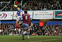 Photo: Lee Earle.<br /> Portsmouth v Aston Villa. The Barclays Premiership. 02/12/2006. Portsmouth's Matthew Taylor (L) scores their first.