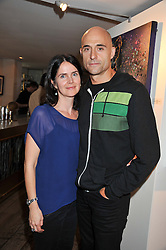 Actor MARK STRONG and his wife LIZA MARSHALL at a party to celebrate the publication on The House of Rumour by Jake Arnott held at The Ivy Club, West Street, London on 9th July 2012.