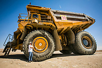 Miner Chuck Kinnear stands by a 240 ton truck at the Rio Tinto Borax mine. Photo by David Sprague