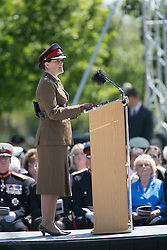 © Licensed to London News Pictures. 11/06/2015. National Memorial Arboretum, Alrewas, Staffordshire, UK. The service to mark the Rededication of the Bastion Memorial. The memorial was begun in Helmand Province in 2006, deconstructed in 2014 and now replicated at the National Memorial Arboretum in Staffordshire. Around two thousand people took part in the service including HRH Prince Harry, the Prime Minister David Cameron and senior members of the Armed Forces. Pictured, MAJOR KATE PHILP  giving her speech Photo credit : Dave Warren/LNP
