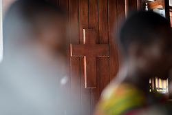 3 November 2019, Monrovia, Liberia: A cross decorates the church door at the Saint Andrew Lutheran Parish in Monrovia. Part of the Lutheran Church in Liberia, the parish gathers some 220 members for prayer each week.