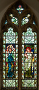 Stained glass window depicting Hope and Love designed by Henry Holiday 1890s, Fressingfield church, Suffolk, England, UK