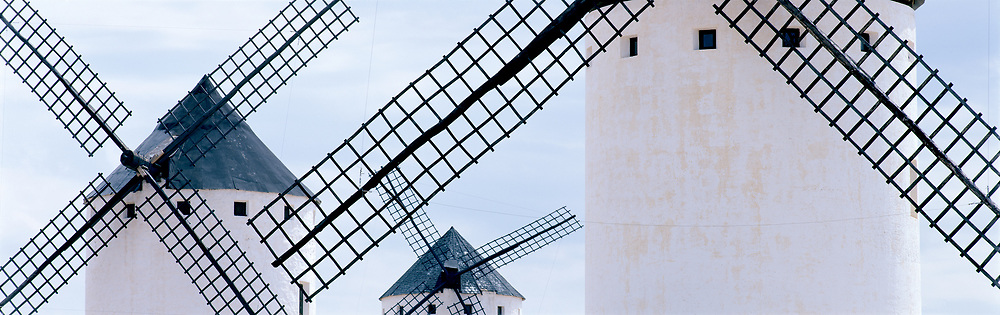 Windmills blues, long lens with towers