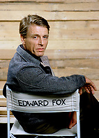 """British actor Edward Fox seen on the set of the film 'Wild Geese 2"""" in London in 1984. Copyright © Terry Fincher 1984. Contact us: hello@classicphotoeditions.com for publication fees and permissions."""