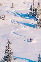 Skier making S-turns on Teton Pass in Jackson Hole Wyoming.
