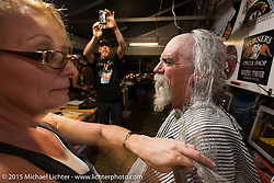 "Mailman gets shaved in the Chop-In Blocks ""Biker Beard-Off"" to benefit the Aidan Jack Seeger foundation for ALD at the Cackleberry Campground during Daytona Beach Bike Week, FL, USA. Thursday, March 12, 2015.  Photography ©2015 Michael Lichter."