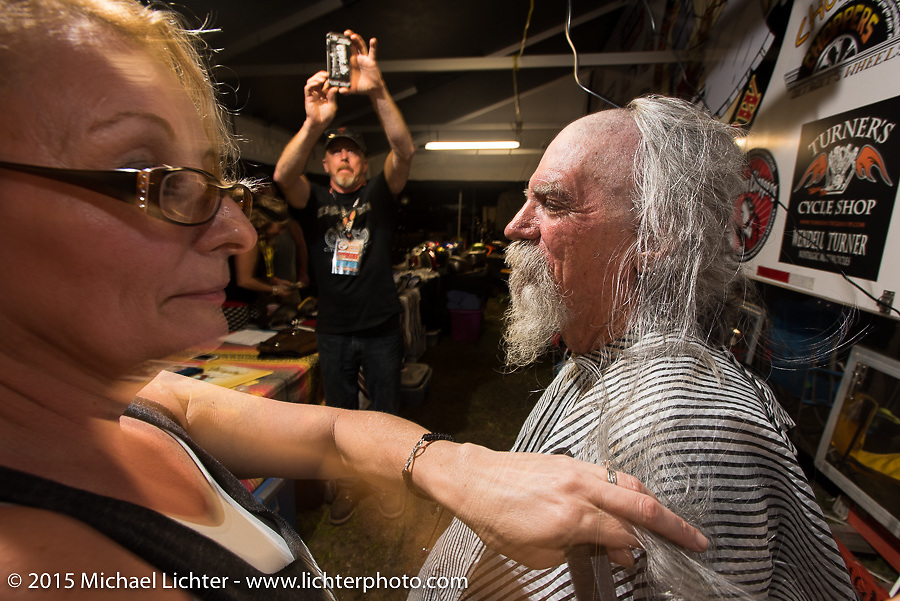 """Mailman gets shaved in the Chop-In Blocks """"Biker Beard-Off"""" to benefit the Aidan Jack Seeger foundation for ALD at the Cackleberry Campground during Daytona Beach Bike Week, FL, USA. Thursday, March 12, 2015.  Photography ©2015 Michael Lichter."""