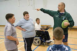 Children with disabilities playing rugby,