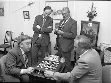 Chess Grand Masters, Clerys,Dublin 1, Ireland.1982.06.05.1982.05.06.1982.6th May 1982.USSR Chess Grandmaster visits Clerys. Mr Yefim Geller made a personal appearance in Clerys. Clerys sponsored the visit in conjunction with the Irish Chess Union, in agreement with the Russian Chess Federation.. .As Mr Geller plays against Mr Arthur Walls (CEO Clerys) they are watched by Mr Denis Ryan (Co Secretary) and Mr Donie Keane (General Manager Retail).
