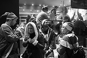 OUTSIDE MACDONALDS, Revellers dressed as Father Christmas on a pub crawl, Strand, , London. 10 December 2016