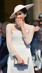 The Duchess of Sussex at a garden party at Buckingham Palace in London which she is attending as her first royal engagement after being married.