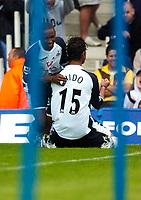 Photo: Alan Crowhurst.<br /> Portsmouth v Tottenham Hotspur. Barclaycard Premiership.<br /> 13/08/2005. Mido celebrates his goal with Defoe.