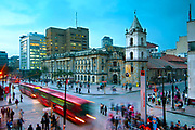 At the intersections of Avendia Jimenez and Carrera Septima, red Transmilenio buses pull into the Museum of Gold station in front of the16th century Iglesia de San Francisco, Bogota's oldest restored church.