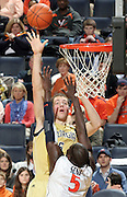 Jan. 22, 2011; Charlottesville, VA, USA; Georgia Tech Yellow Jackets center Daniel Miller (5) shoots over Virginia Cavaliers center Assane Sene (5) during the game at the John Paul Jones Arena. Virginia won 72-64. Mandatory Credit: Andrew Shurtleff-US PRESSWIRE