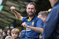 AFC Wimbledon fan celebrating after win during the EFL Sky Bet League 1 match between Southend United and AFC Wimbledon at Roots Hall, Southend, England on 12 October 2019.