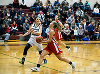 Prospect Mountain's Alison Brown and Laconia's Sophie George take the court for first round play in the 44th annual Holiday Basketball Tournament played at Gilford Middle/High School on Wednesday afternoon.  (Karen Bobotas/for the Laconia Daily Sun)