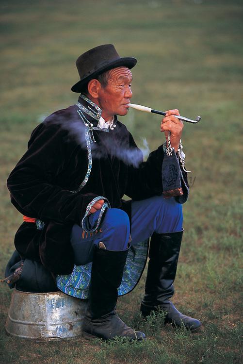 Smoking traditional pipe<br /> Naadam festival<br /> Ulaanbaatar race track<br /> Mongolia